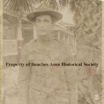 Image of James L. Gavagan -  James L. Gavagan in  WW I uniform with unidentified house in background.