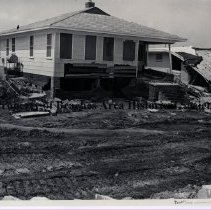 Image of Damage to Jacksonville Beach houses. - Hurricane Dora; September 1964;   view of house with extensive damage to brick front steps, brick foundation, lower siding and porch supports; as well as damage to concrete block side-wall, Jacksonville Beach