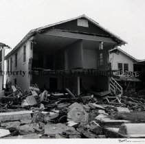 Image of Damage to Jacksonville Beach houses. - Hurricane Dora; September 1964; House next to house shown in previous  photo.Really extensive damage; entire front of two-story house torn off.