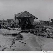 Image of Damage to Jacksonville Beach houses. - Hurricane Dora; September 1964;12th Ave, South on right; E.V.E. Larson house