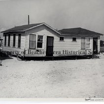 Image of Hurricane Dora 1964; Damage to Jacksonville Beach houses - Hurricane Dora; September 1964; photo shows damage to two of Frederick E. Williams Rental cottages; 1233 N. 1st Street, between 11th Ave N. and 12th Ave. N..these cottages have undermined foundation