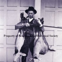 Image of Travis R. Hayman - Travis R Hayman pictured with two deer he shot with one shot in Palm Valley. Mr. Hayman was born August 8, 1881, and died May, 1962