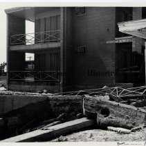 Image of Hurricane Dora 1964; Damage to Neptune Beach motel - Hurricane Dora; September 1964; view of damage to Sea Horse Motel on Atlantic Blvd in Neptune Beach. View from side shows  collapsed railing and first-floor balcony torn away from side of building.