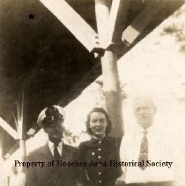 Image of FEC employees - Louise Jones, City ticket agent, pictured with Mr. Kirk, passenger representative and Mr. Ingraham, Assistant passenger agent, Florida East Coast Railroad. Picture apparently taken in train station.