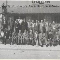 Image of Beaches Rotary Club Luncheon Group - Beaches Rotary Club Luncheon group in front of Davis Sea Shell. Left to right standing: (unknown), Dr. H.A. Prather, Congressman Emory Price, Frank Doggett, Harley DeLoach, Floyd Hostetter, Fred Allen, (unknown), Linton Floyd, John Pyatt, J.B. Arnot, Walter Berry, Editor Ocean Beach Reporter, Bill Heeney, Gilbert Cotton, Rev. Bob Mackay. Seated:  (unknown), Ed Smith, (unknown), Crowley Davis, Ish Brant, Jim Rupert, Thelma Keith, L.B. Phillips, J.f. Kearney, Roy Davis.