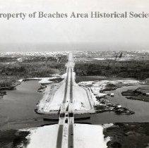 "Image of Bird's eye view of Beach Blvd. - - Jacksonville Beach, Florida -   Aerial view of Beach Blvd. from Intercoastal waterway east to beach.    Site of future yacht basin  ""Beach Marina"" on left, and McCormick Bridge -center."