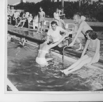 Image of At the Pool at the Ponte Vedra Club - Ponte Vedra Beach, Florida Two couples featured at the Ponte Vera Club pool. Other swimmers in background.