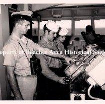 "Image of Navy offficers at bridge of USS Saratoga - Navy Officers at the bridge of the USS Saratoga on the reverse of the photo its labled: ""Saratoga EM on bridge.""  U.S. Navy, Sailors, Mayport, Wheel house."