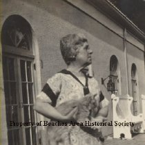 Image of Mrs. Lillie Estill Rannie ( Mrs. William Ross Rannie). - Jacksonville Beach, Florida  ( ca . 1926 or 1927 Mrs. Lillie Estill  Rannie (Mrs.Wiliam Ross Rannie) with a cat at Timucuana Country Club in Ortega section of Jacksonville.
