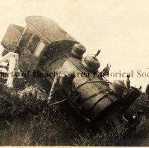 Image of George Pritchard working on derailed locomotive. - Mineral City, Florida  Mr. George Pritchard  working on locomotive that had derailed at Buckman & Pritchard Sand Plant.
