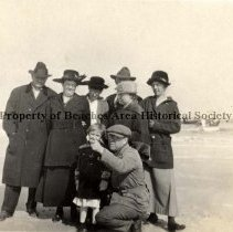Image of Eight unidentified people in heavy winter coats on beach. - Mineral City, Florida ,1919  Eight unidentified prople in heavy winter coats on beach.