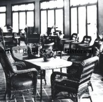Image of Glassed -In Porch, Atlantic Beach Hotel - Atlantic Beach, Florida  Atlantic Beach Hotel.  Inside view of glassed-in front porch with wicker chairs and tables.