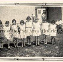 Image of Girls at Grammar School #50 - Jacksonville Beach, Florida Nine little girls in school yard of Elementary Grammar School #50. Fourth from left is Elizabeth Patrick.