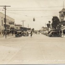 Image of Jacksonville Beach at Pablo Avenue Street Scene - Jacksonville Beach, Florida - 1943 Pablo Avenue: Left side: ARNOT Building, with Arnot's's Bakery and Meals, next door PRIEST $.5 cents to $1.00. Across the street: Club Breakfast on the corner.
