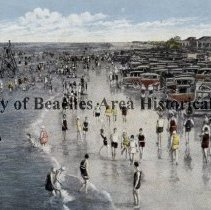 Image of Surf bathing in Jacksonville Beach - Jacksonville Beach, Florida ( early 1930's)  Cars are parked on the hard packed sand; surf bathing