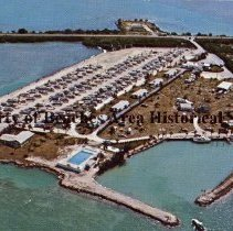 """Image of Fiesta Key Resort - Fiesta Key Resort Fiesta Key Fla. 33001 Phone A.C. 305-664-4922 At Milepost 70 on the Florida Keys. A 28-acre island paradise in the heart of the world-famous Florida Keys. America's finest fishing grounds. Complete, modern facilities for travel trailers and campers. Pool, motel, store, and restaurant on the island. """"Fiesta Key Is The Place To Be""""  Color photo: aerial of resort surrounded by water"""