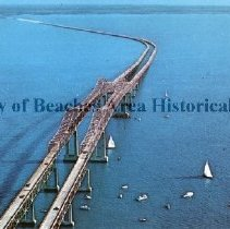 Image of The Skyway Twins - The Skyway Twins Twin Span - Famous Sunshine Skyway Bridge  Famous Sunshine Skyway Twin Span Sweeps 15 miles across Tampa Bay -- Short route between St. Petersburg and Bradenton, Florida showing Twin Spans 150.5 feet above ocean-going Liner Channel. A series of causeways and beaches on either end of the structure provide family recreation: fishing, boating, swimming and picnicking.   Florida State Series  Color photo