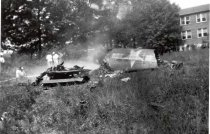 Image of Plane Crash - Aerial view of site of 1945 plane crash behind the State (Hiser) Theater on Wisconsin Ave. Part of fuselage of Navy Hellcat which crashed in Bethesda. Source: William Offutt.