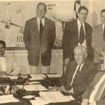 Image of Rockville's Young Turks - Rockville's Young Turks, circa 1956: seated, left to right, are Councilman Alexander Greene, Councilman Frank Ecker, Mayor Dickran Hovsepian, Councilman Wendell Turner and Councilman John Oxley.  Standing, left to right,  are City Manager John Markland, City Clerk Milton Millan, City Engineer Joseph Rogers, City Attorney David Cahoon and City Planner Rovert Plavnik, 1956.