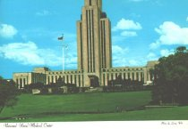 """Image of Naval Medical Center - Color photo of hospital; note that the top of the tower is cut off.  Decorative edge.  Captioned on front; """"National Naval Medical Center, Photo by Larry Witt.""""  Printed on reverse: """"National Naval Medical Center. Just south of Interstate 495 on Wisconsin Avenue in Bethesda, Maryland.  Commissioned in 1942, one of the finest institutions of its kind.  It functions as a medical, dental, diagnostic, educational, and research, and is composed of the following commands: Naval Hospital, Naval Medical School, Naval Graduate Dental School, Naval School of Health Care Administration, Naval Medical Research Institute, and Navy Toxicology Unit.  Distributed by LB Prince Co, Fairfax.""""  unsent, no message."""