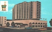 """Image of Holiday Inn - Color illustration of Holiday Inn.  Printed on reverse: """"the only Holiday Inn in Bethesda, Md.  8120 Wisconsin Avenue, Bethesda, Maryland 20014. Ph. (301) 652-2000.  2 Miles South of Exit 19 and I-495.  10 minutes from DC - Rooftop Pool.  Adjacent to NIH & Bethesda Naval Hospital - 267 rooms and suites - All color TV - Banquet and meeting rooms from 10 to 1000 - featuring fine dining in three French Quarter restaurants.""""  unsent, no message."""