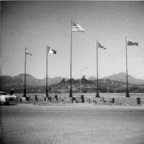Image of Five flags at Tubac entrance - Kinsley Arcadia Photo Collection