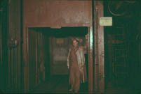 Image of Worker standing inside the elevator underground at the Sunrise Mine