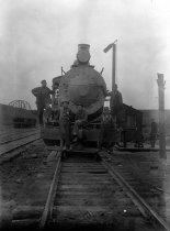 Image of Workers on a C&W locomotive