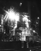 """Image of Furnace """"F"""" under construction.  Night view of welding on furnace shell."""