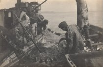 Image of 1997.106 - Fishermen pulling in seine net