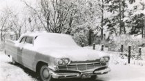Image of Snow-covered car