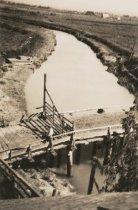 Image of river with bridge across it