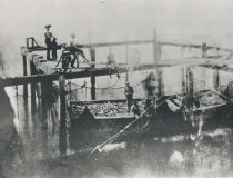 "Image of Brailing; ""lifting"" a fish trap in 1920's"