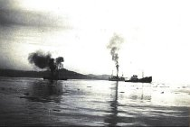 "Image of Clallam Bay with ""Lincoln"" on the rocks."
