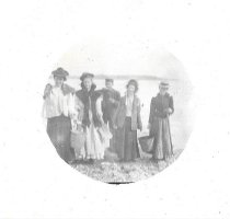 Image of Ladies and one gentleman at the beach. (2002.039.038.B)