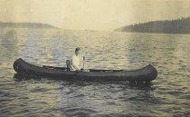 Image of 2002.039.048 - Postcard of man in canoe, 1911.
