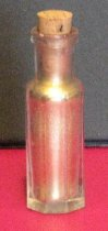 Image of Glass bottle with gold paint residue
