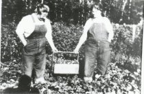 Image of 2002.123.018.A,B - Strawberry pickers Hannah & Julia Elvebak