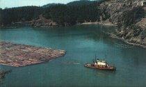 Image of Palomar towing logs.