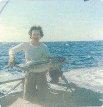 Image of Steve Jamison holding albacore tuna