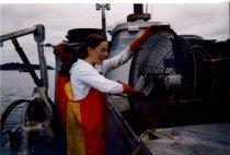 Image of Julie Crews emptying shrimp pot
