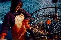 Image of Patty Crews handling crab pot.