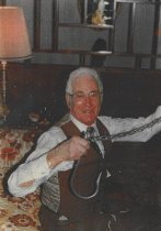 Image of Bill Bessner with shark hook.