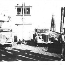 Image of Augie Olson standing on the Deception Pass ferry - 1935