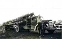 Image of Ted Anstensen w/his log truck