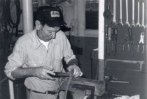 Image of Stan Nelson, crewman, splicing rope.
