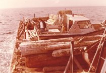 Image of Logs and skiff on bow of W.T. Preston.