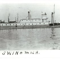 Image of SWINOMISH unloading barge at Webster Point, 1928.