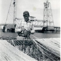 Image of Ed Knudson mending nets