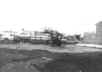Image of Pettibone loader unloading pipe (.102)